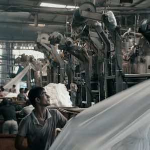 "Workers in a textile mill in a scene from the movie ""Machines""s """